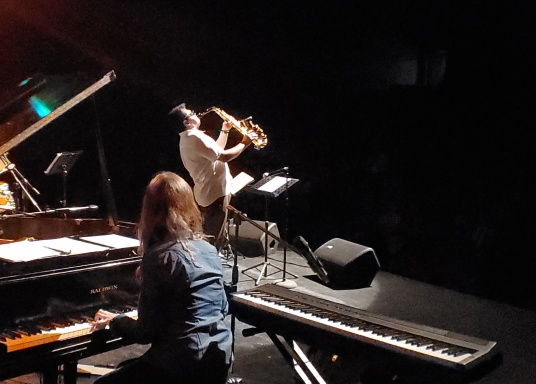 Sofía Ramírez plays tehe grand piano while Gerry Lopez blasts he sax. Ajijic. 8.15.19